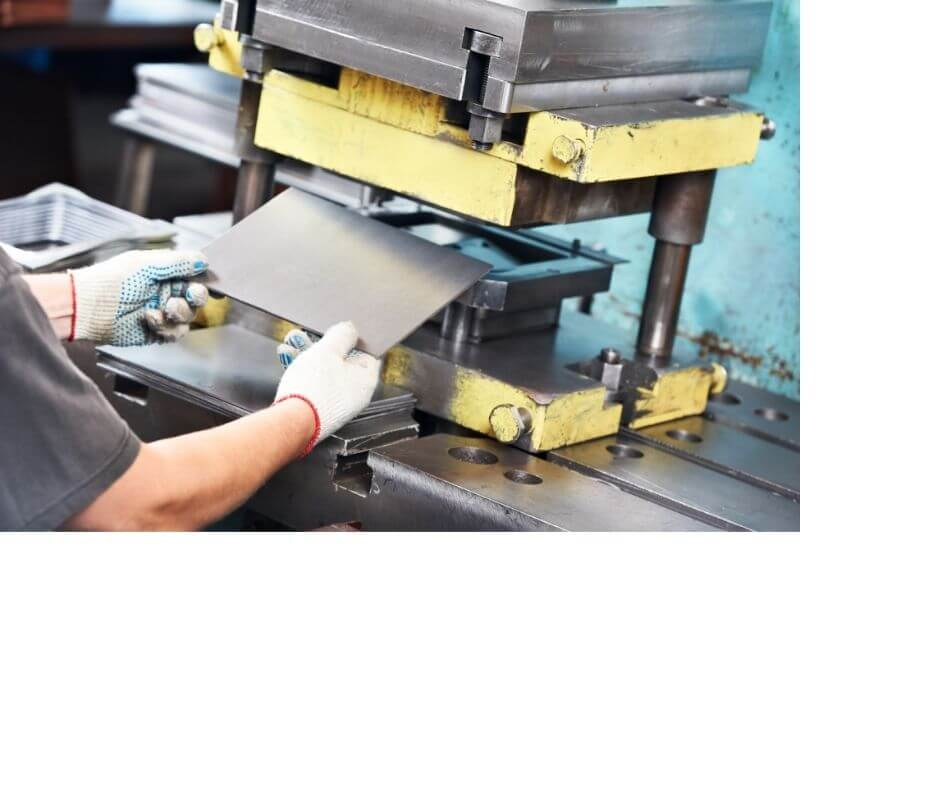 worker-operating-metal-sheet-press-machine